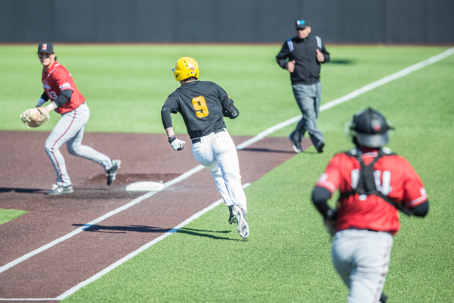 Iowa+outfielder+Ben+Norman+rounds+first+base+during+the+first+game+of+a+baseball+doubleheader+between+Iowa+and+Cal-State+Northridge+at+Duane+Banks+Field+on+Sunday%2C+March+17%2C+2019.+The+Hawkeyes+defeated+the+Matadors%2C+5-4.