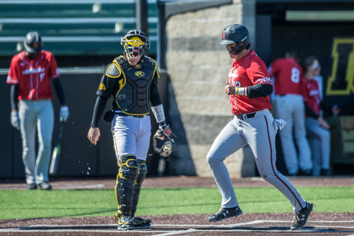 CSUN+infielder+Wesley+Ghan-Gibson+scores+during+the+first+game+of+a+baseball+doubleheader+between+Iowa+and+Cal-State+Northridge+at+Duane+Banks+Field+on+Sunday%2C+March+17%2C+2019.+The+Hawkeyes+defeated+the+Matadors%2C+5-4.