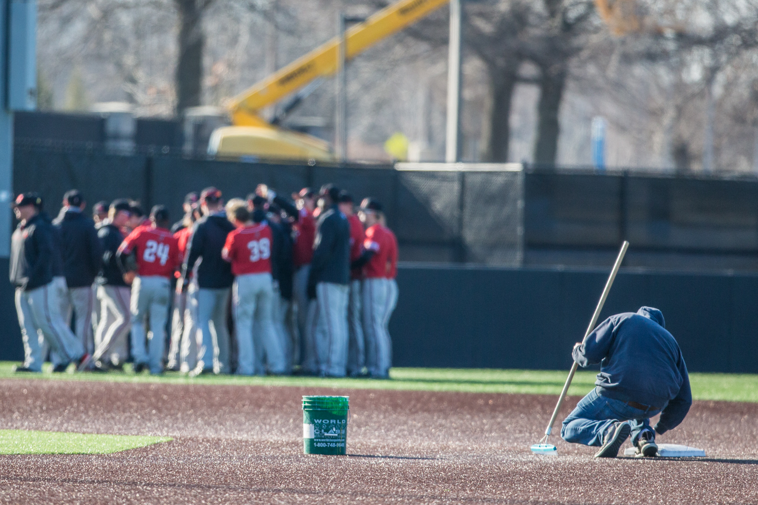 Groundskeepers+maintain+the+infield+between+games+during+a+baseball+doubleheader+between+Iowa+and+Cal-State+Northridge+at+Duane+Banks+Field+on+Sunday%2C+March+17%2C+2019.