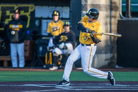 Iowa outfielder Trenton Wallace swings while at-bat during the second game of a baseball doubleheader between Iowa and Cal-State Northridge at Duane Banks Field on Sunday, March 17, 2019. The Hawkeyes took the series by defeating the Matadors, 3-1.