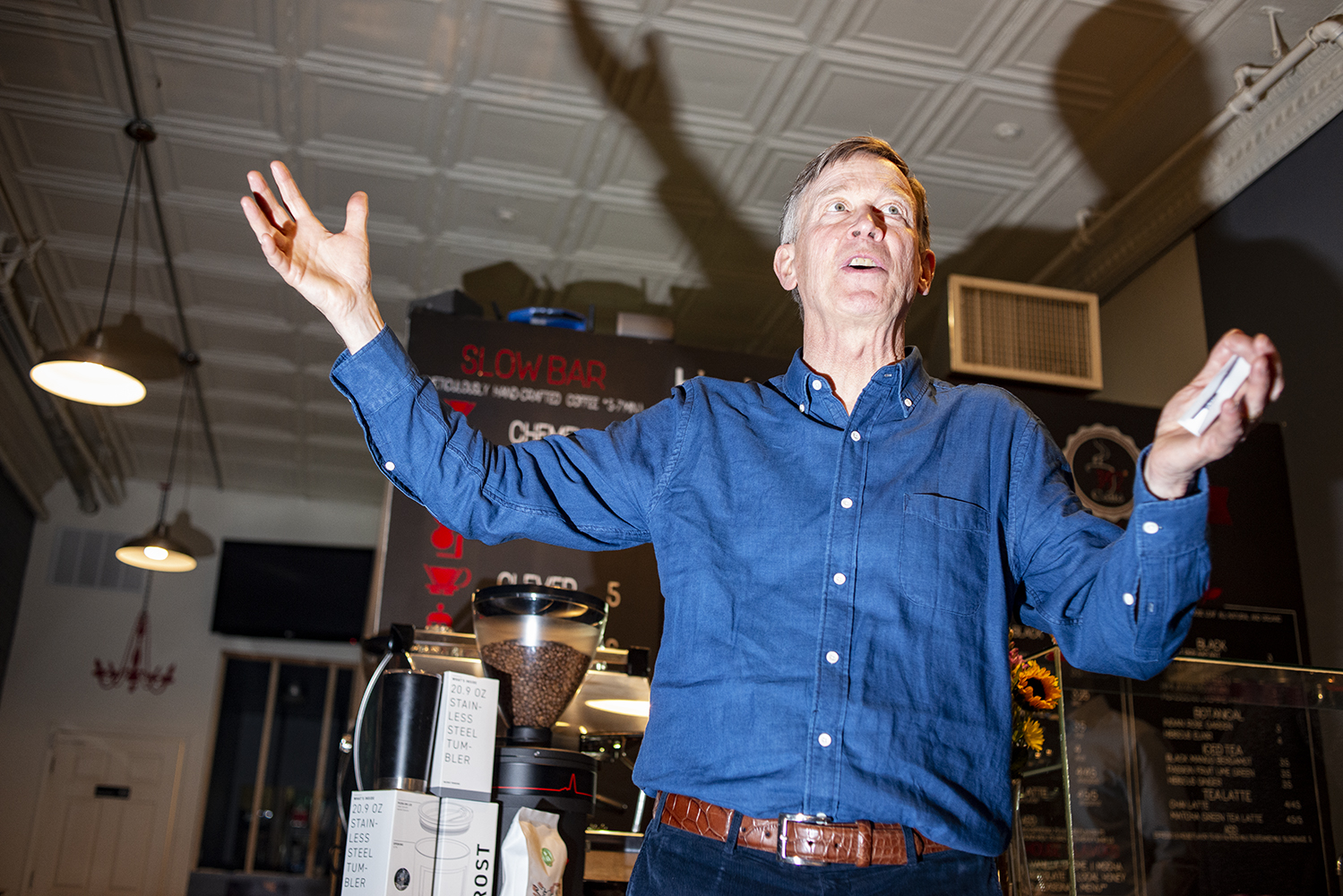 Former Colorado Gov. John Hickenlooper speaks during a campaign stop at the 392 Caffé in Clinton, Iowa on Saturday, March 9, 2019.