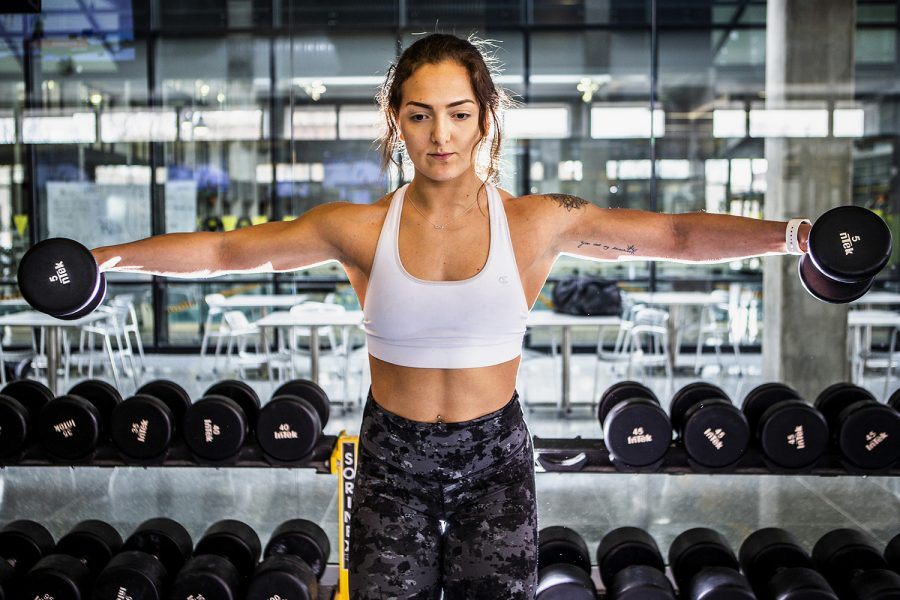 Camille+Lazzarotto+lifts+weights+at+the+CRWC+on+Wednesday%2C+March+6%2C+2019.+Lazzarotto+is+an+athletic+trainer+at+the+recreation+center+and+works+out+in-between+the+times+she+has+clients.+