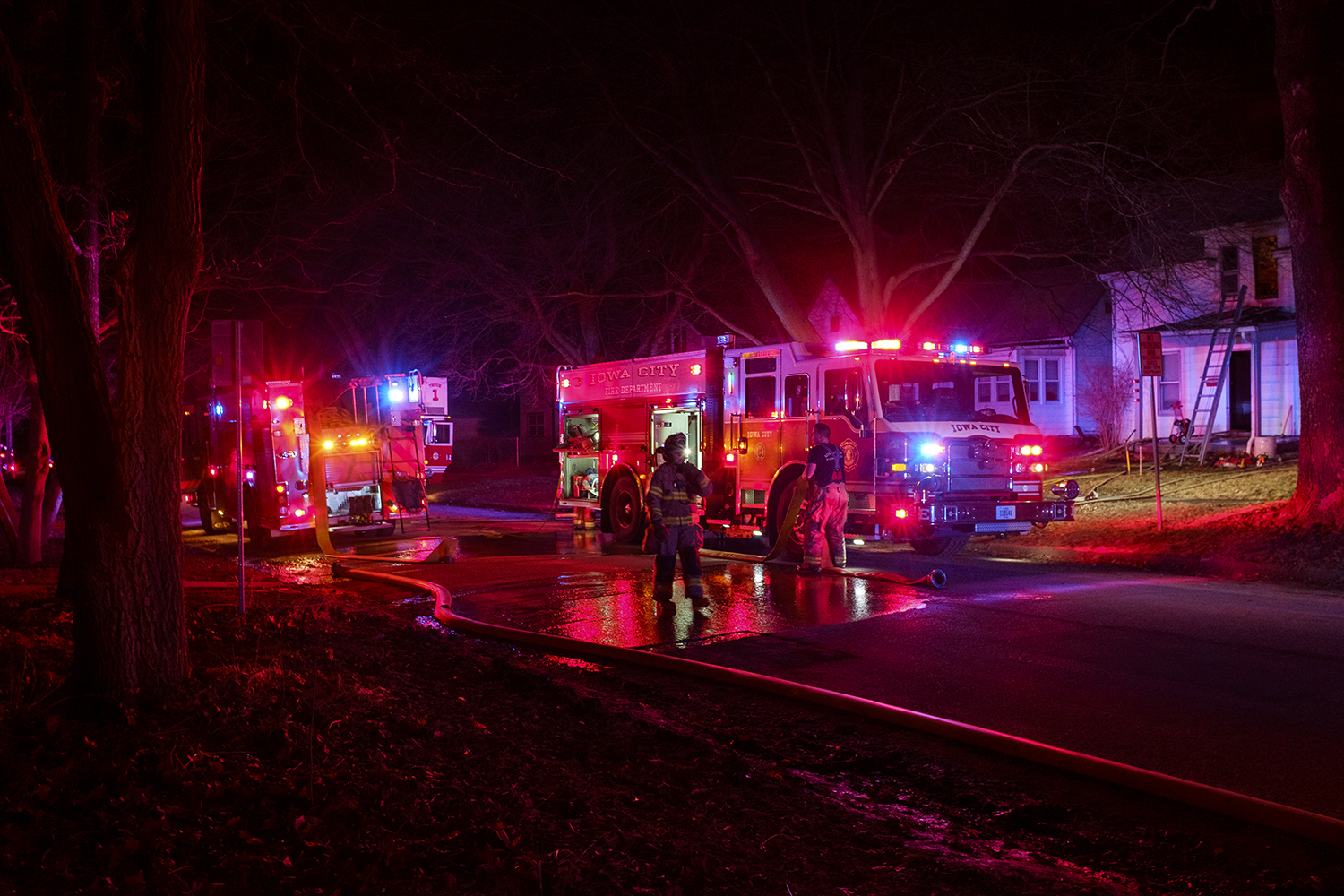 Firefighters respond to a report of a fire at a residence on Davenport Street in Iowa City on Tuesday, March 19, 2019.
