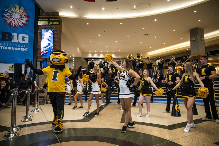 Iowa cheerleaders, the Iowa pep band, and Herky the Hawk cheer before the women's Big Ten Championship basketball game vs. Maryland at Bankers Life Fieldhouse on Sunday, March 10, 2019.