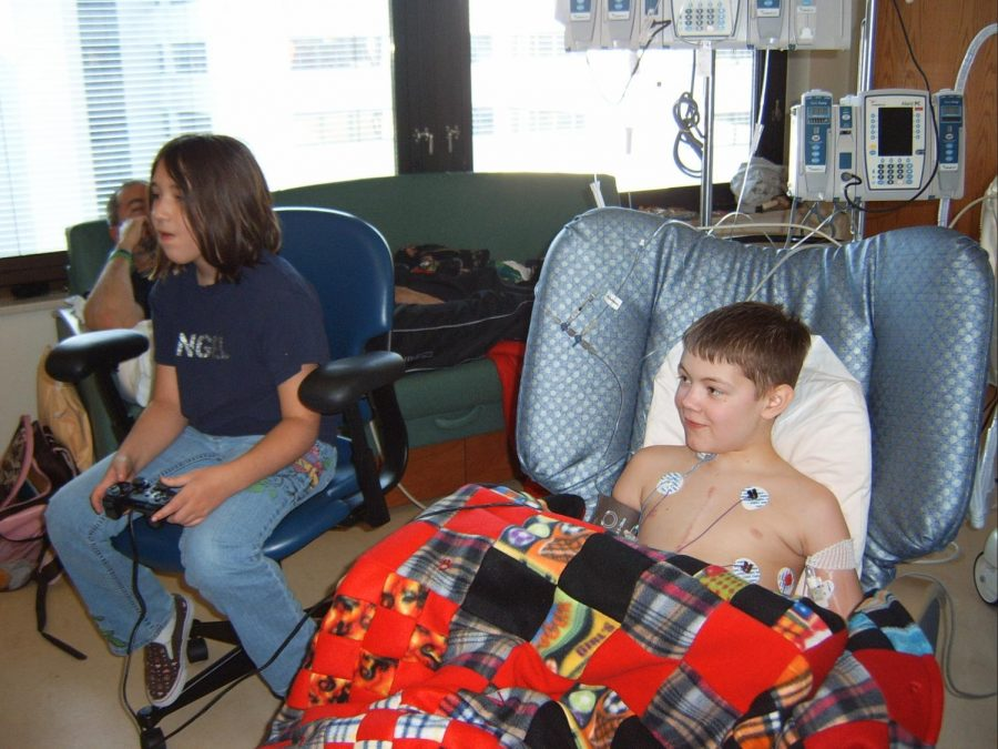 Bryce and Brooklyn Draisey play video games on a PlayStation 2. Bryce often played video games at home, so it was one of his favorite pastimes while he was in the hospital.