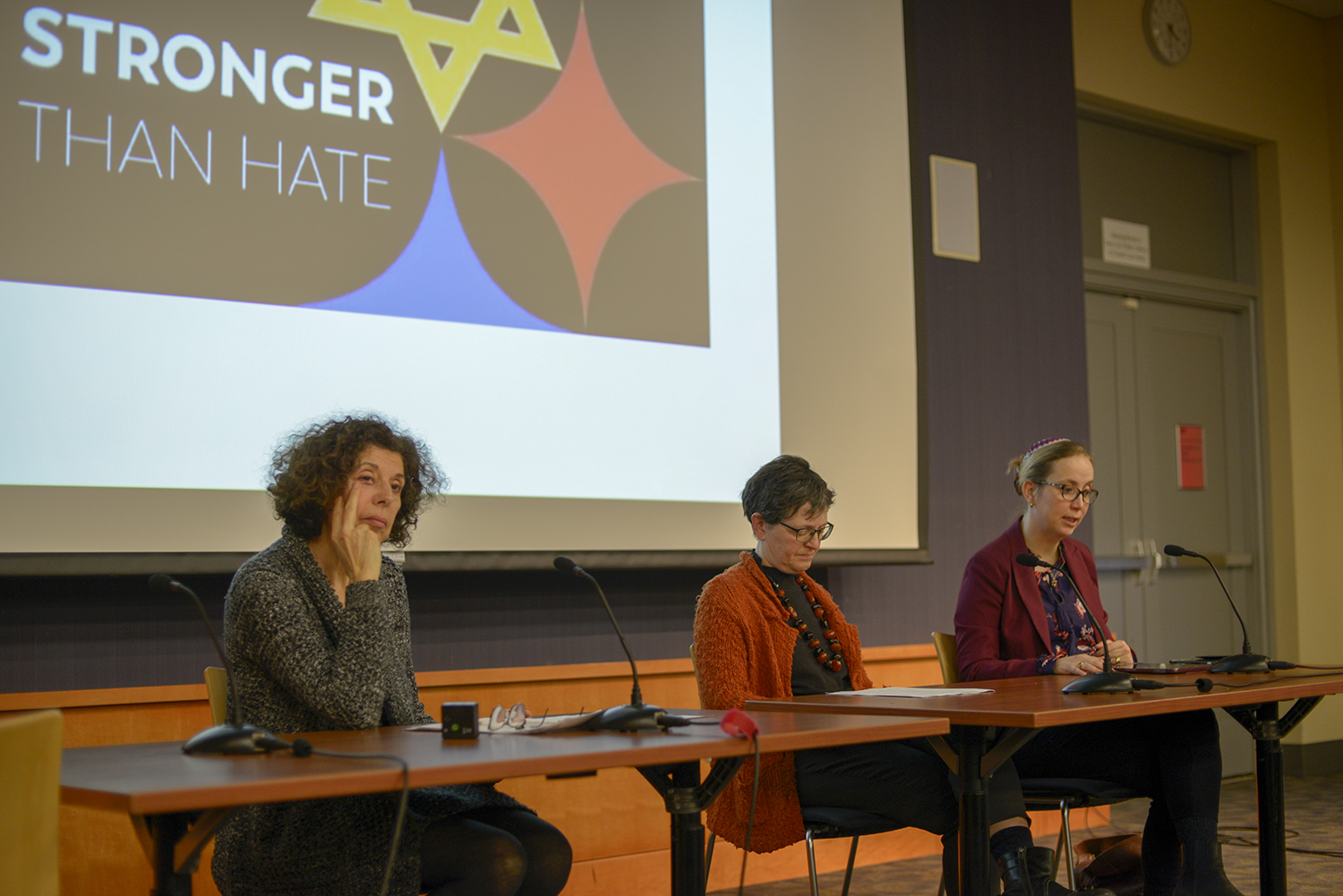 "Poet Esther Dischereit (left,) Professor Elizabeth Heineman, and Rabbi Esther Hugenholtz discuss the rise in American and European anti-Semitism in the Iowa City Public Library on Thursday, March 14. The panel discussion, entitled ""Resurgent Antisemitism and the Importance of Historical Remembering,"" postulated the causes and potential solutions to prejudice."