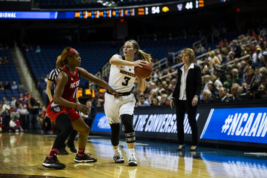 Iowa guard Makenzie Meyer prepares to pass the ball during the NCAA Sweet 16 game against NC State at the Greensboro Coliseum Complex on Saturday, March 30, 2019. The Hawkeyes defeated the Wolfpack 79-61.