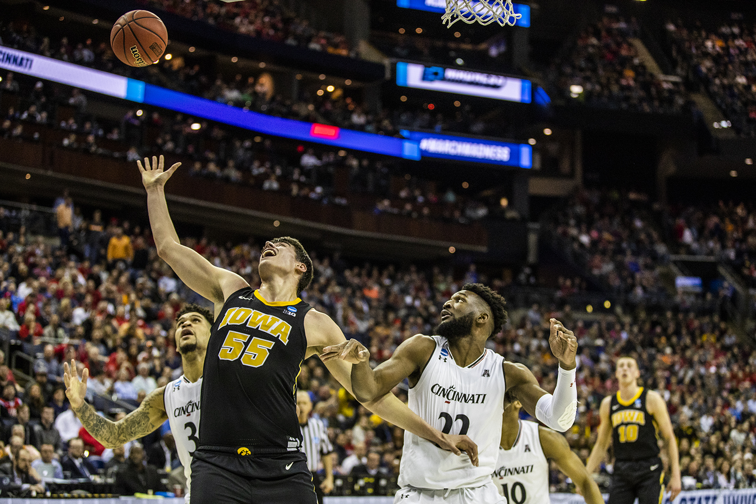 Iowa guard Luka Garza reaches for the ball during the NCAA game against Cincinnati at Nationwide Arena on Friday, March 22, 2019. The Hawkeyes defeated the Bearcats 79-72.