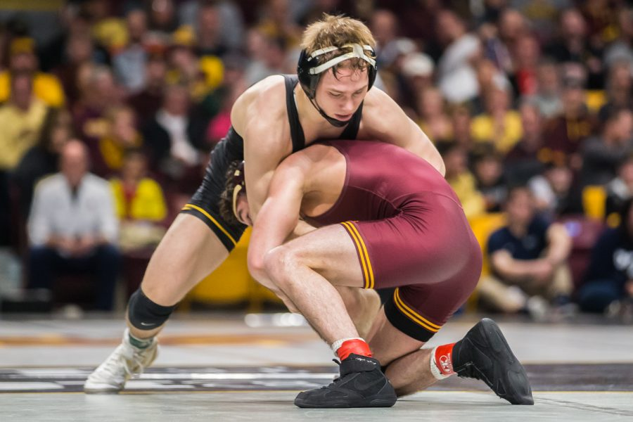 Iowa%27s+125-lb+Spencer+Lee+wrestles+Minnesota%27s+Sean+Russell+during+the+second+session+of+the+2019+Big+Ten+Wrestling+Championships+in+Minneapolis%2C+MN+on+Saturday%2C+March+9%2C+2019.+Lee+won+by+major+decision%2C+8-0.+