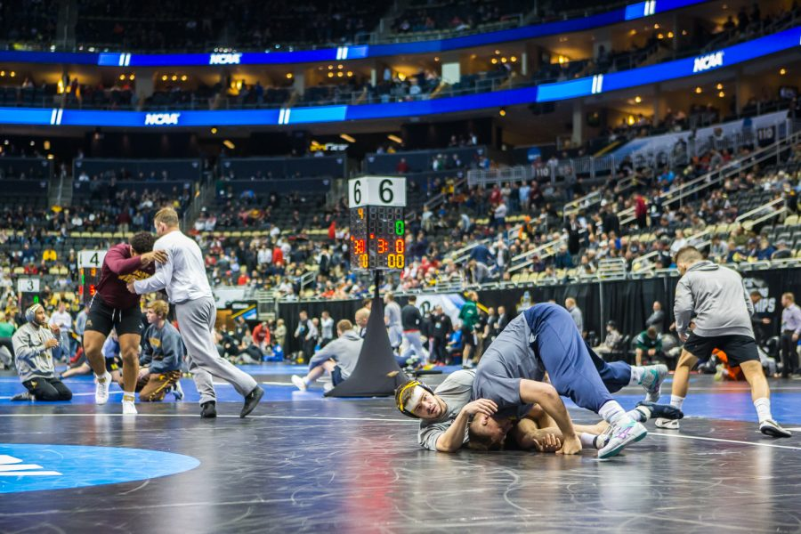 Wrestlers+warm+up+on+the+mats+before+the+third+session+of+the+2019+NCAA+D1+Wrestling+Championships+at+PPG+Paints+Arena+in+Pittsburgh%2C+PA+on+Friday%2C+March+22%2C+2019.