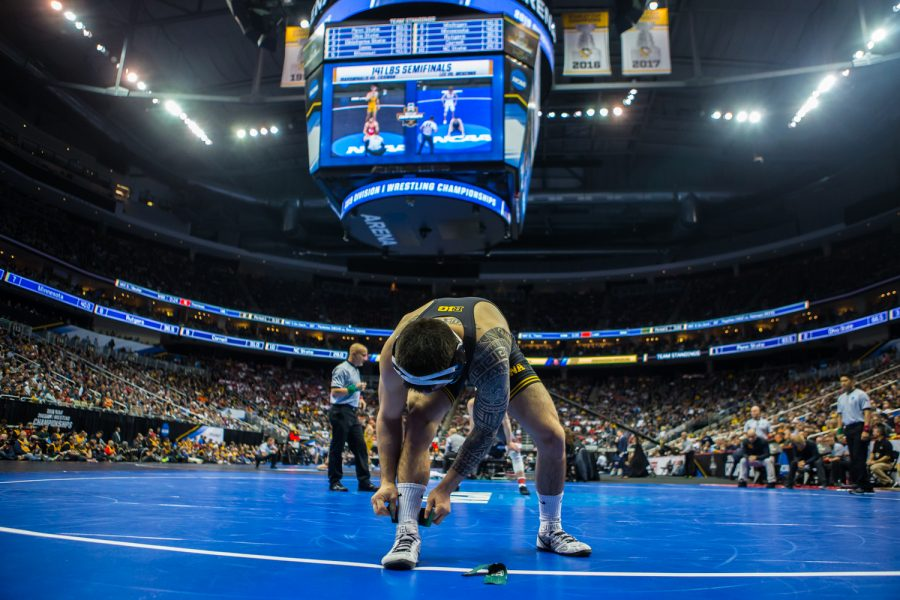 Iowa%E2%80%99s+149-pound+Pat+Lugo+prepares+to+wrestle+Minnesota%E2%80%99s+Thomas+Thorn+during+the+fourth+session+of+the+2019+NCAA+D1+Wrestling+Championships+at+PPG+Paints+Arena+in+Pittsburgh%2C+PA+on+Friday%2C+March+22%2C+2019.+Lugo+won+by+decision%2C+4-0.