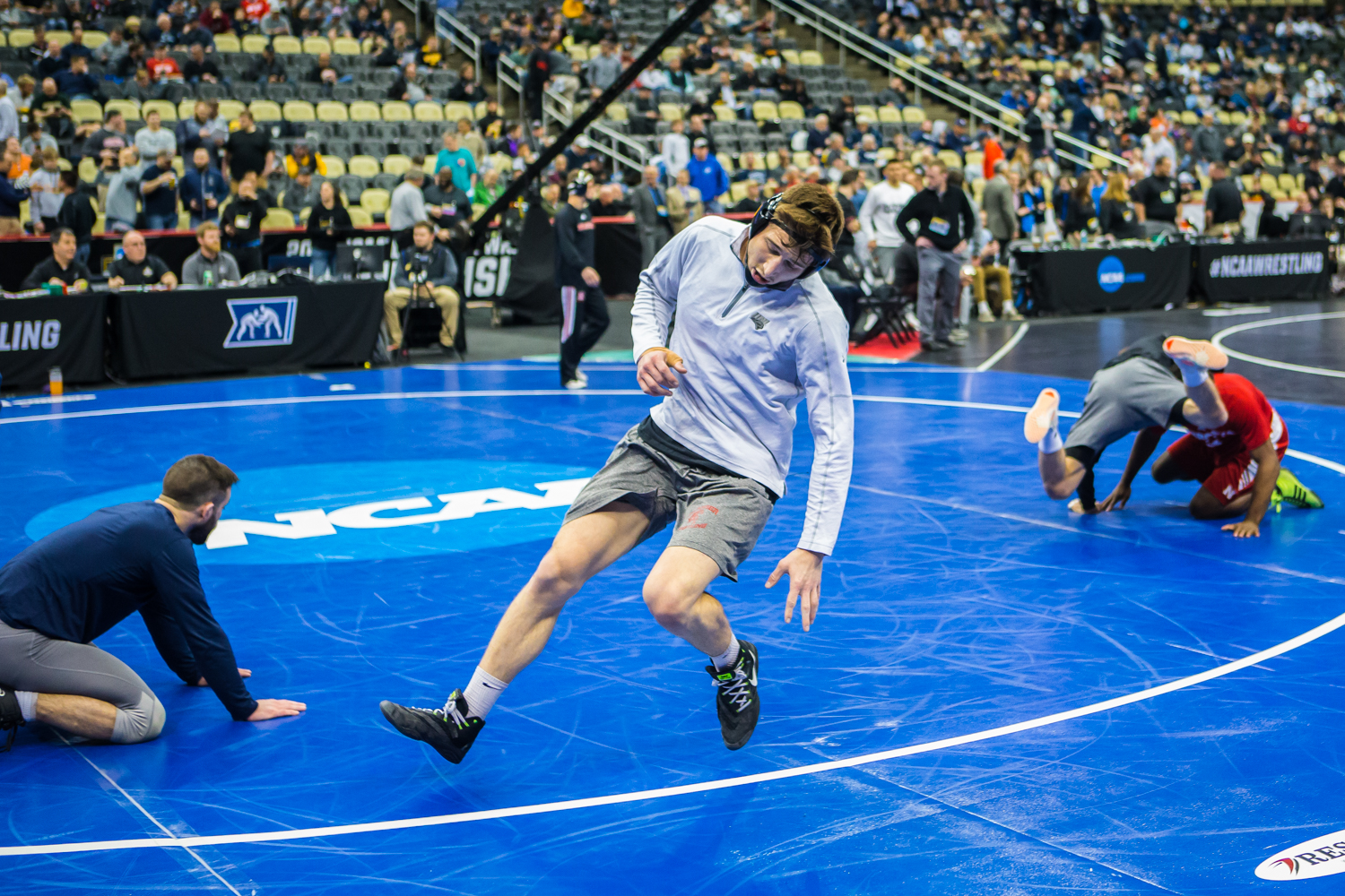 A+wrestler+runs+across+the+mats+during+the+fourth+session+of+the+2019+NCAA+D1+Wrestling+Championships+at+PPG+Paints+Arena+in+Pittsburgh%2C+PA+on+Friday%2C+March+22%2C+2019.+Berger+won+by+decision%2C+5-3.