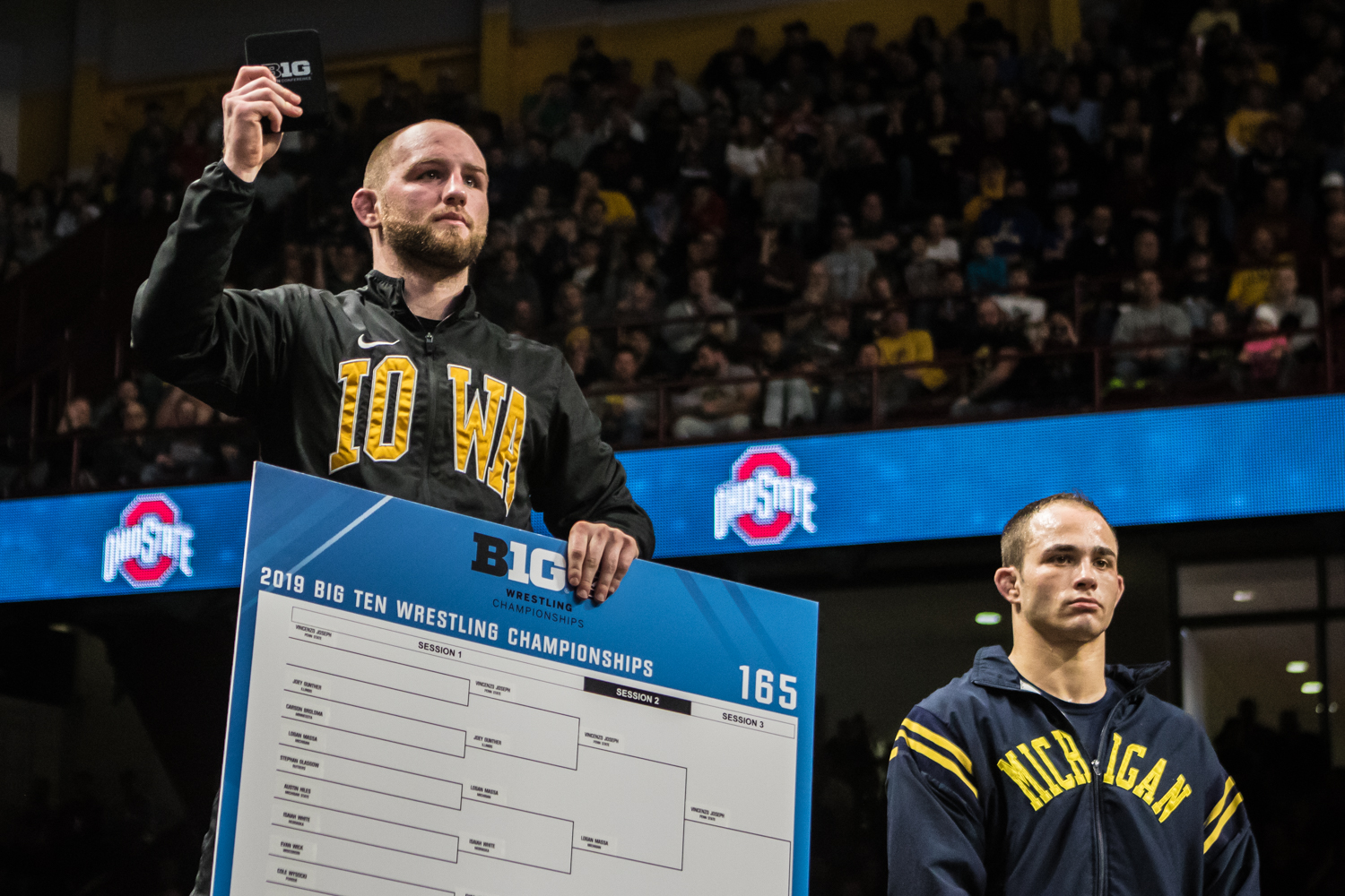 Iowa's Alex Marinelli is awarded first in the 165-lb weight class during the fourth session of the 2019 Big Ten Wrestling Championships in Minneapolis, MN on Sunday, March 10, 2019.