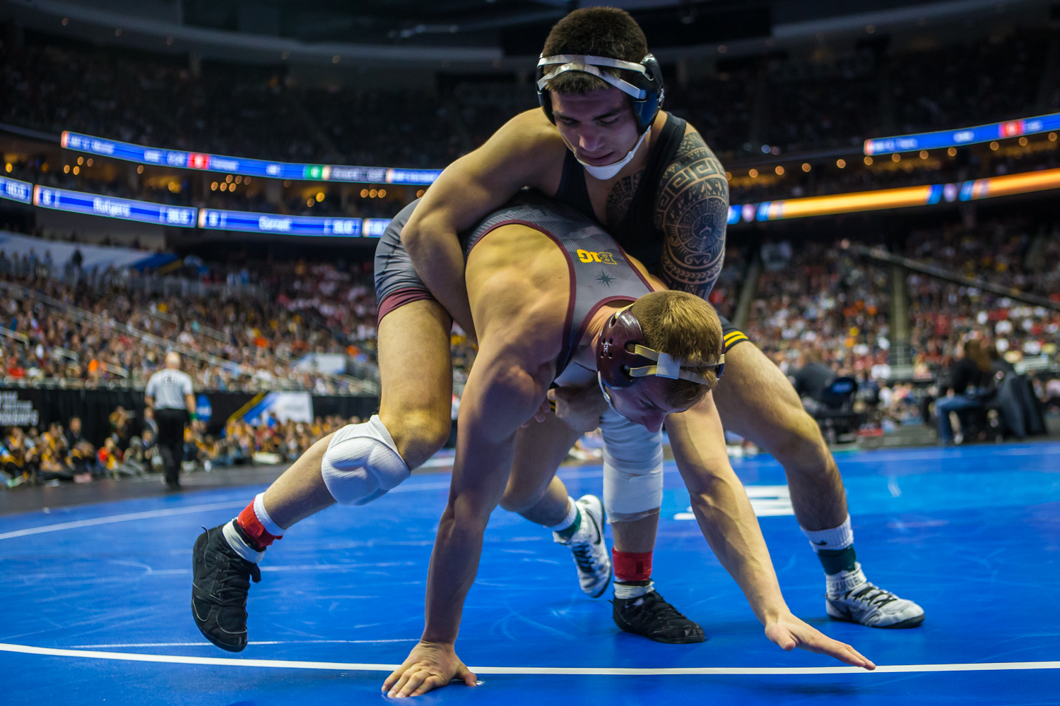 Iowa%E2%80%99s+149-pound+Pat+Lugo+wrestles+Minnesota%E2%80%99s+Thomas+Thorn+during+the+fourth+session+of+the+2019+NCAA+D1+Wrestling+Championships+at+PPG+Paints+Arena+in+Pittsburgh%2C+PA+on+Friday%2C+March+22%2C+2019.+Lugo+won+by+decision%2C+4-0.