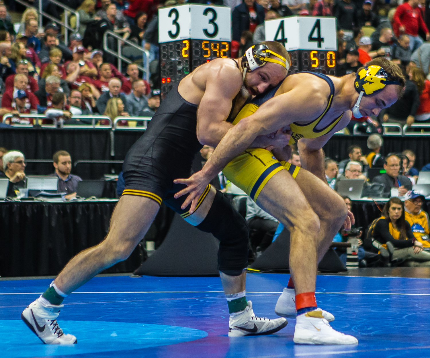 Iowa%E2%80%99s+165-pound+Alex+Marinelli+wrestles+Michigan%E2%80%99s+Logan+Massa+during+the+fourth+session+of+the+2019+NCAA+D1+Wrestling+Championships+at+PPG+Paints+Arena+in+Pittsburgh%2C+PA+on+Friday%2C+March+22%2C+2019.+Marinelli+won+by+decision%2C+5-3.