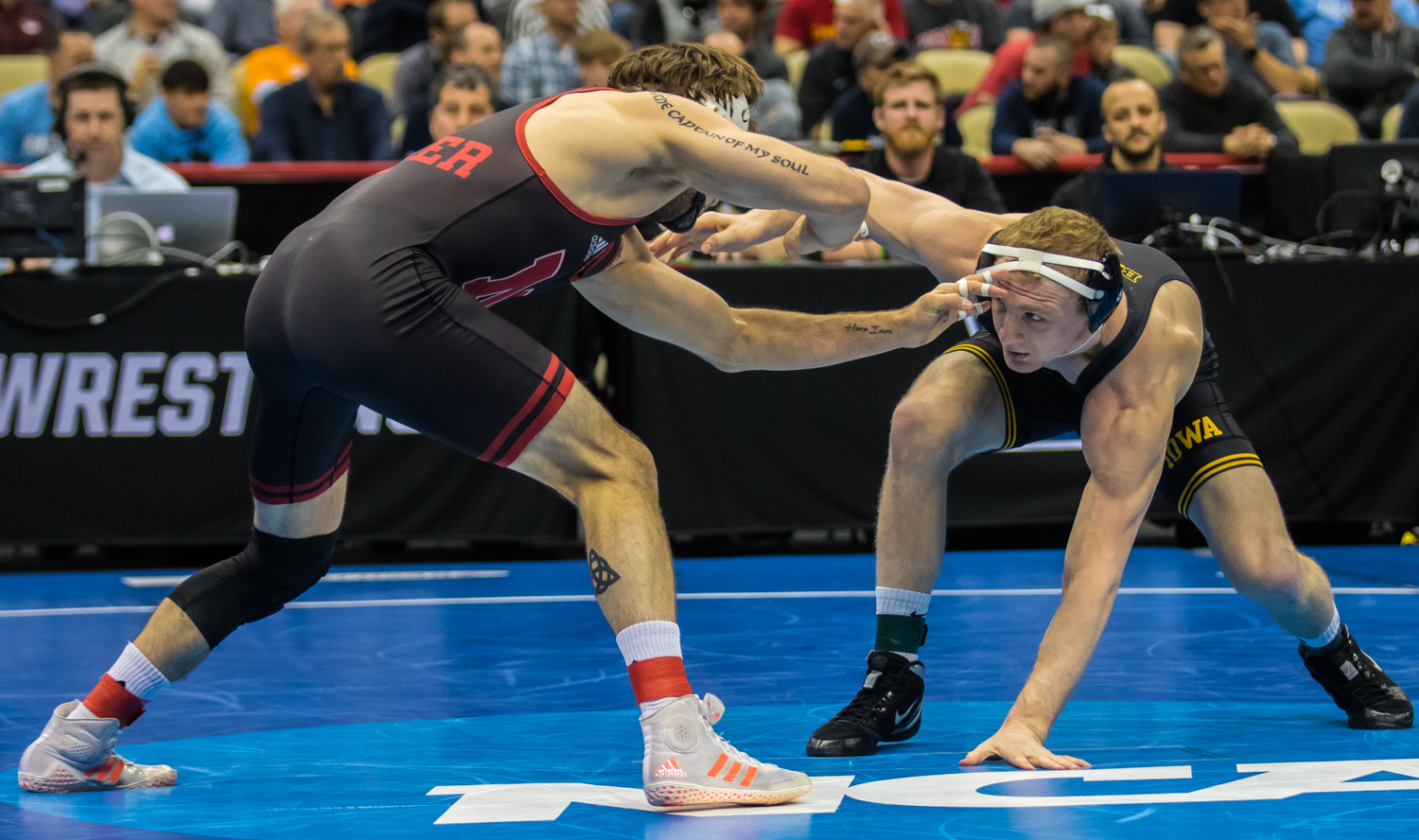 Iowa%E2%80%99s+157-pound+Kaleb+Young+wrestles+Nebraska%E2%80%99s+Tyler+Berger+during+the+fourth+session+of+the+2019+NCAA+D1+Wrestling+Championships+at+PPG+Paints+Arena+in+Pittsburgh%2C+PA+on+Friday%2C+March+22%2C+2019.+Berger+won+by+decision%2C+5-3.