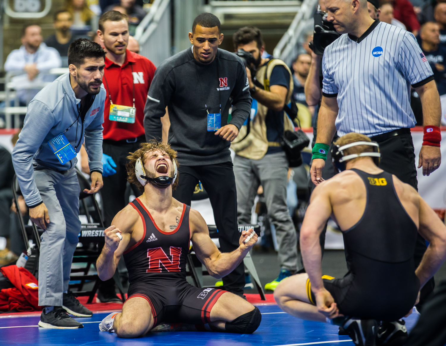 Nebraska%E2%80%99s+Tyler+Berger+celebrates+defeating+Iowa%27s+Kaleb+Young+during+the+fourth+session+of+the+2019+NCAA+D1+Wrestling+Championships+at+PPG+Paints+Arena+in+Pittsburgh%2C+PA+on+Friday%2C+March+22%2C+2019.+Berger+won+by+decision%2C+5-3.