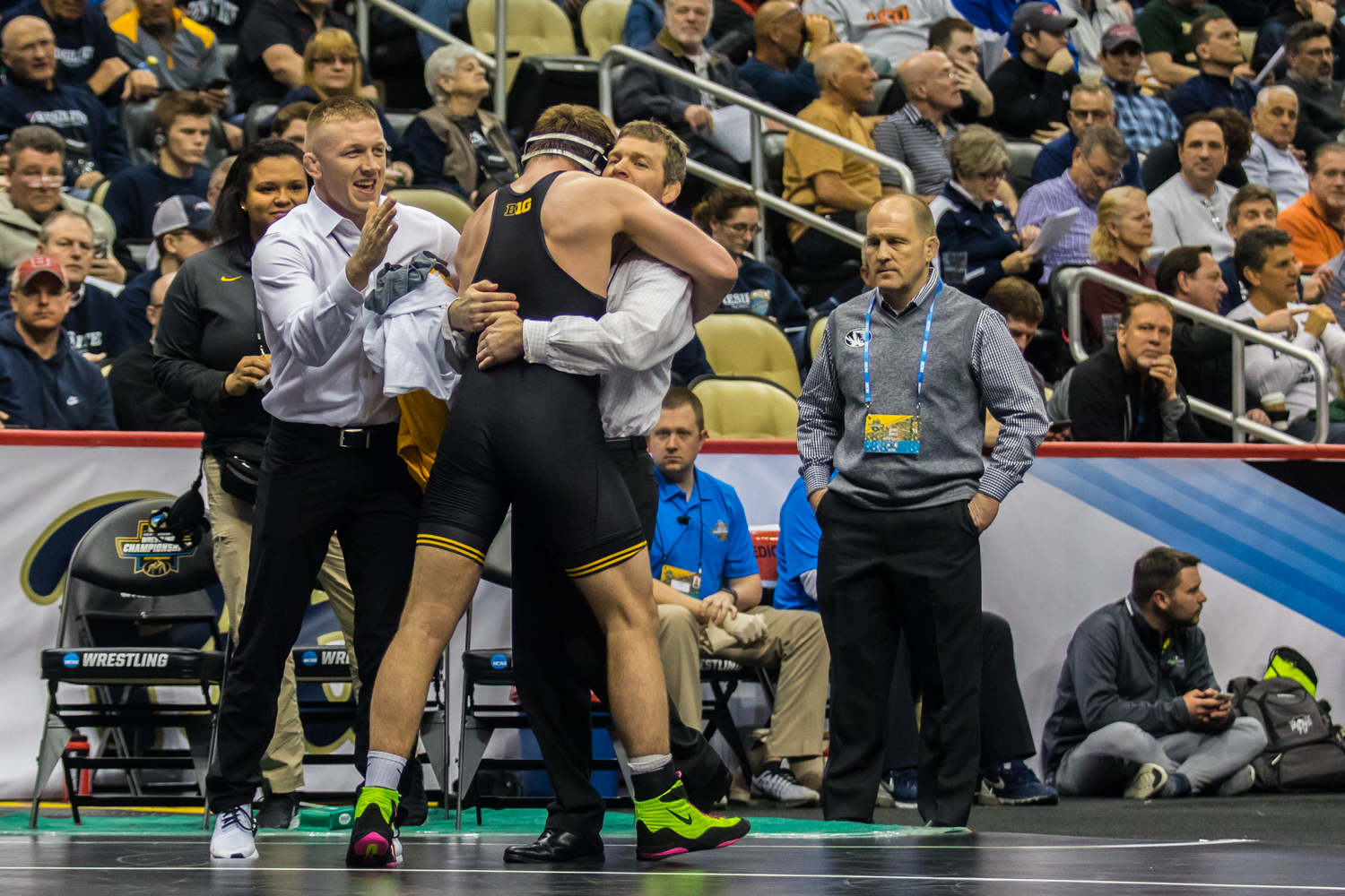 Iowa%E2%80%99s+197-pound+Jacob+Warner+hugs+head+coach+Tom+Brands+after+defeating+Virginia+Tech%E2%80%99s+Tom+Sleigh+during+the+fourth+session+of+the+2019+NCAA+D1+Wrestling+Championships+at+PPG+Paints+Arena+in+Pittsburgh%2C+PA+on+Friday%2C+March+22%2C+2019.+Warner+won+by+decision%2C+6-2.