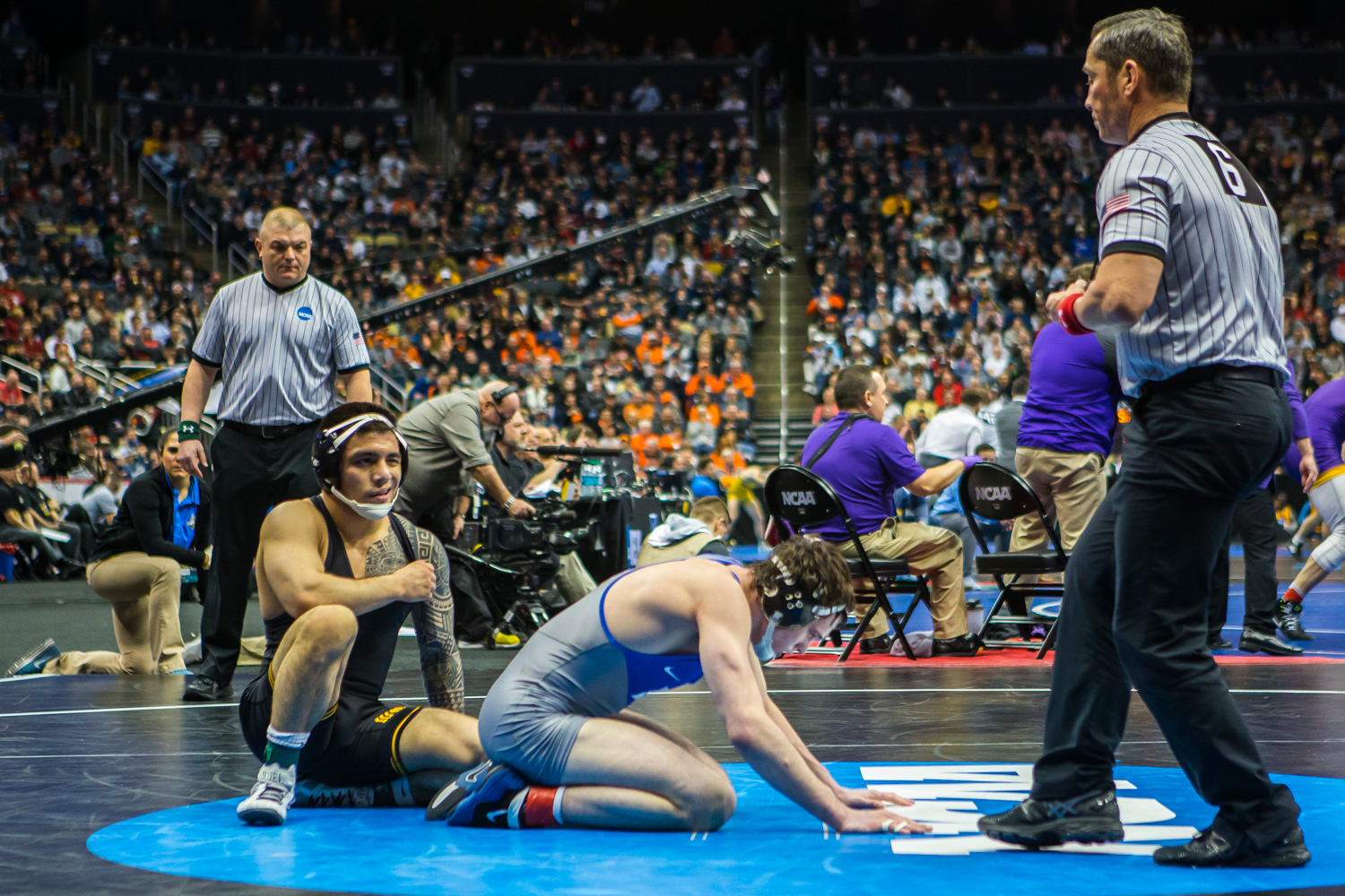 Iowa%E2%80%99s+149-pound+Pat+Lugo+wrestles+Duke%E2%80%99s+Mitch+Finesilver+during+the+fourth+session+of+the+2019+NCAA+D1+Wrestling+Championships+at+PPG+Paints+Arena+in+Pittsburgh%2C+PA+on+Friday%2C+March+22%2C+2019.+Finesilver+won+by+decision%2C+6-3.