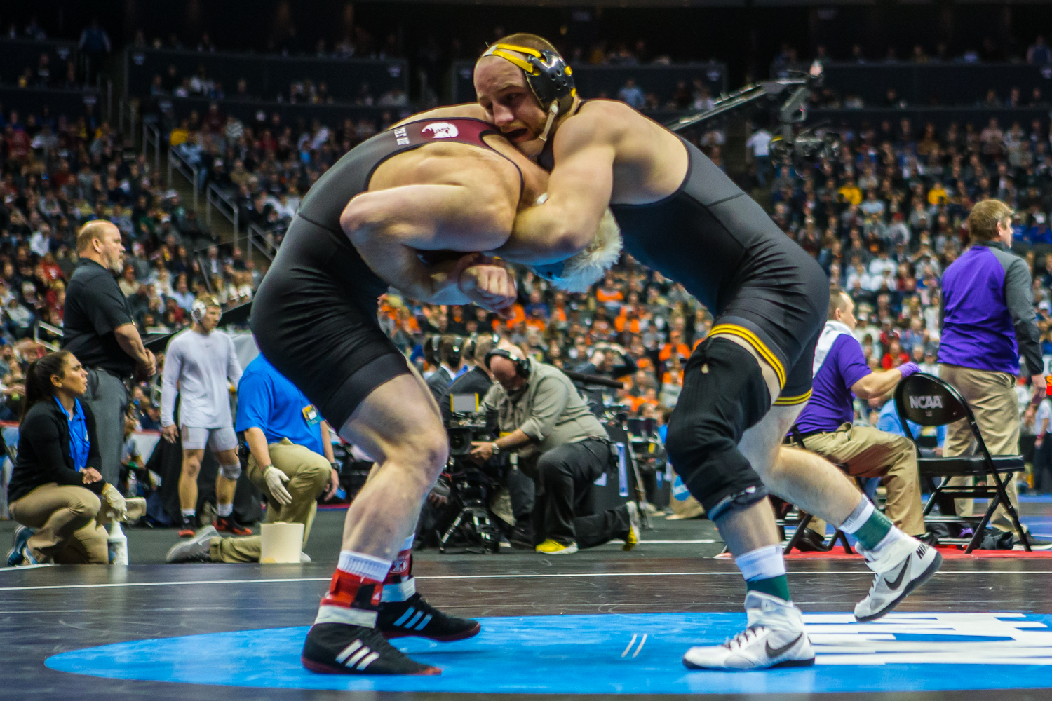 Iowa%E2%80%99s+165-pound+Alex+Marinelli+wrestles+Lock+Haven%E2%80%99s+Chance+Marstellar+during+the+fourth+session+of+the+2019+NCAA+D1+Wrestling+Championships+at+PPG+Paints+Arena+in+Pittsburgh%2C+PA+on+Friday%2C+March+22%2C+2019.+Marstellar+won+by+decision%2C+9-6.