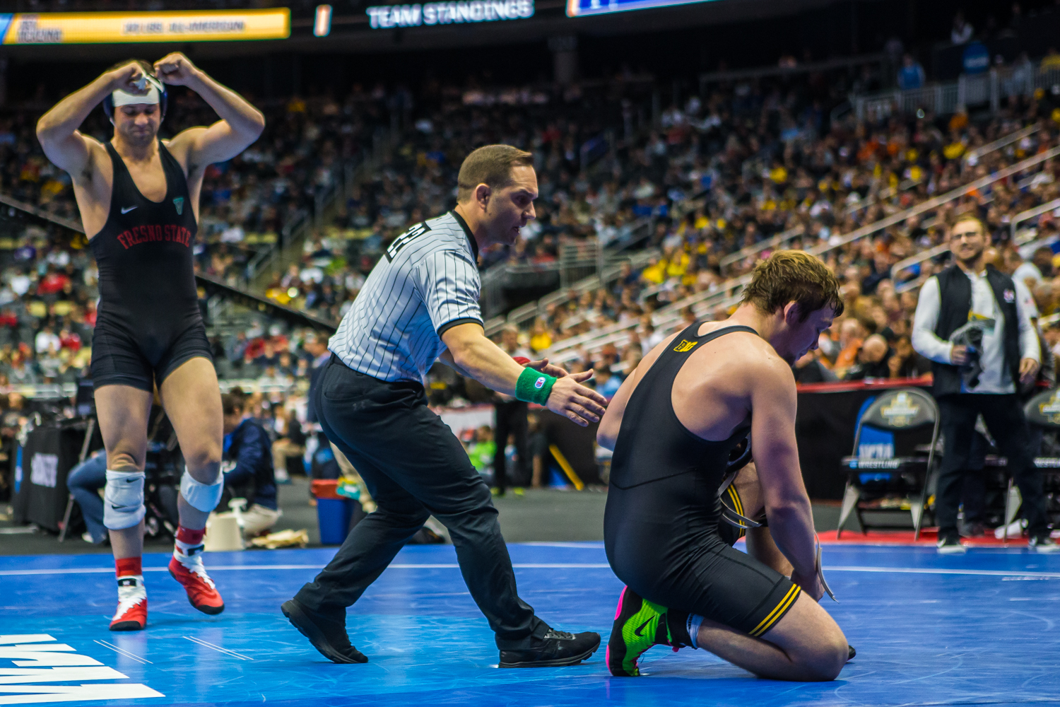 Iowa%E2%80%99s+197-pound+Jacob+Warner+is+defeated+by+Fresno+State%E2%80%99s+Josh+Hokit+during+the+fourth+session+of+the+2019+NCAA+D1+Wrestling+Championships+at+PPG+Paints+Arena+in+Pittsburgh%2C+PA+on+Friday%2C+March+22%2C+2019.+Hokit+won+by+decision%2C+5-4.