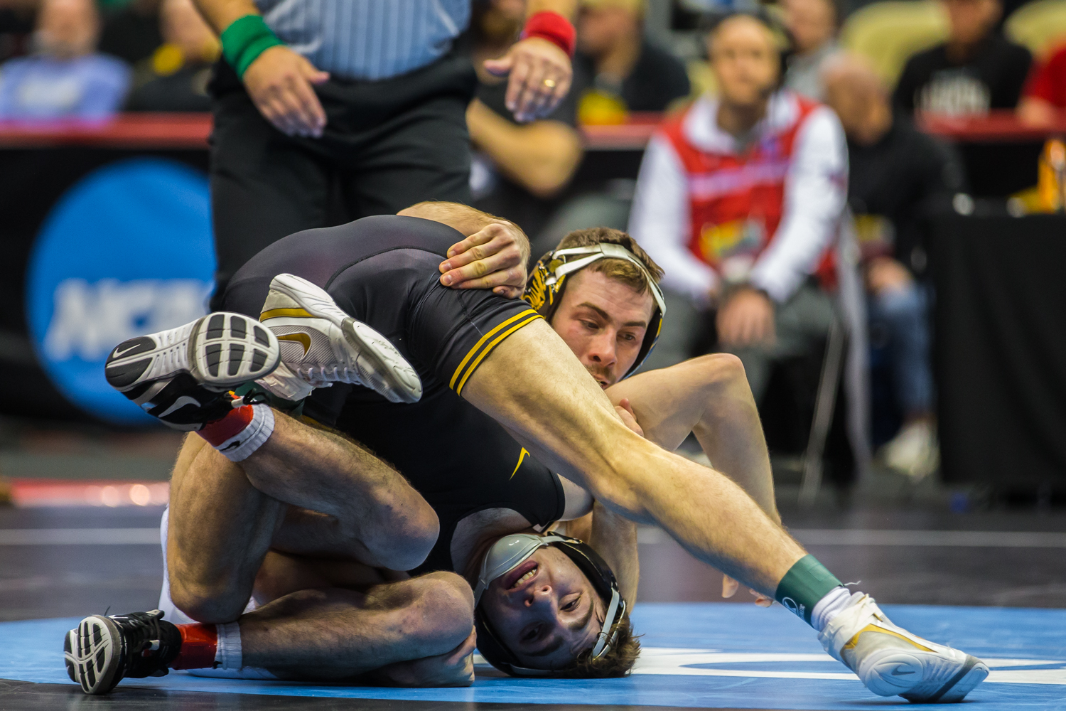 Iowa%E2%80%99s+133-pound+Austin+DeSanto+wrestles+Missouri%E2%80%99s+John+Erneste+during+the+fifth+session+of+the+2019+NCAA+D1+Wrestling+Championships+at+the+PPG+Paints+Arena+in+Pittsburgh%2C+PA+on+Saturday%2C+March+23%2C+2019.+Desanto+won+by+decision%2C+11-6%2C+and+earned+fifth+in+the+weight+class.