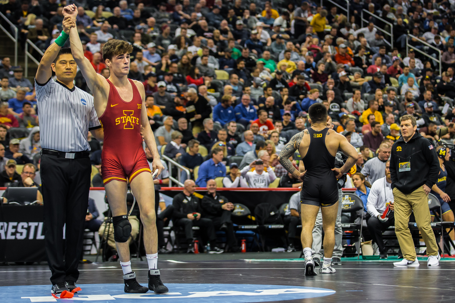 Iowa+State%E2%80%99s+Jarrett+Degen+defeats+Iowa%E2%80%99s+149-pound+Pat+Lugo+during+the+fifth+session+of+the+2019+NCAA+D1+Wrestling+Championships+at+the+PPG+Paints+Arena+in+Pittsburgh%2C+PA+on+Saturday%2C+March+23%2C+2019.+Degen+won+by+decision%2C+11-9%2C+and+earned+seventh+in+the+weight+class.