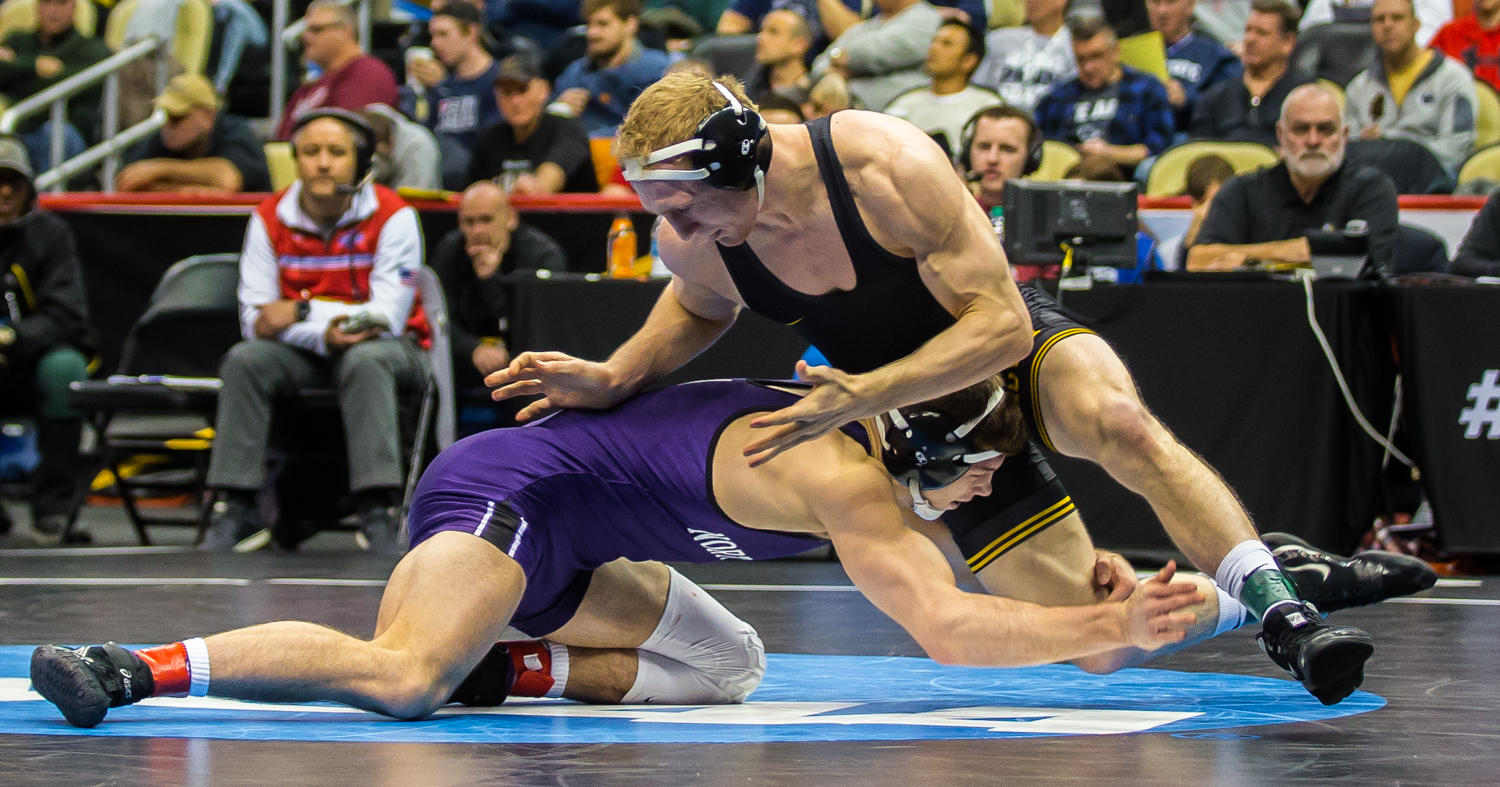 Iowa's 157-pound Kaleb Young wrestles Northwestern's Ryan Deakin during the fifth session of the 2019 NCAA D1 Wrestling Championships at the PPG Paints Arena in Pittsburgh, PA on Saturday, March 23, 2019. Young won by sudden victory, 7-5, and earned fifth in the weight class.