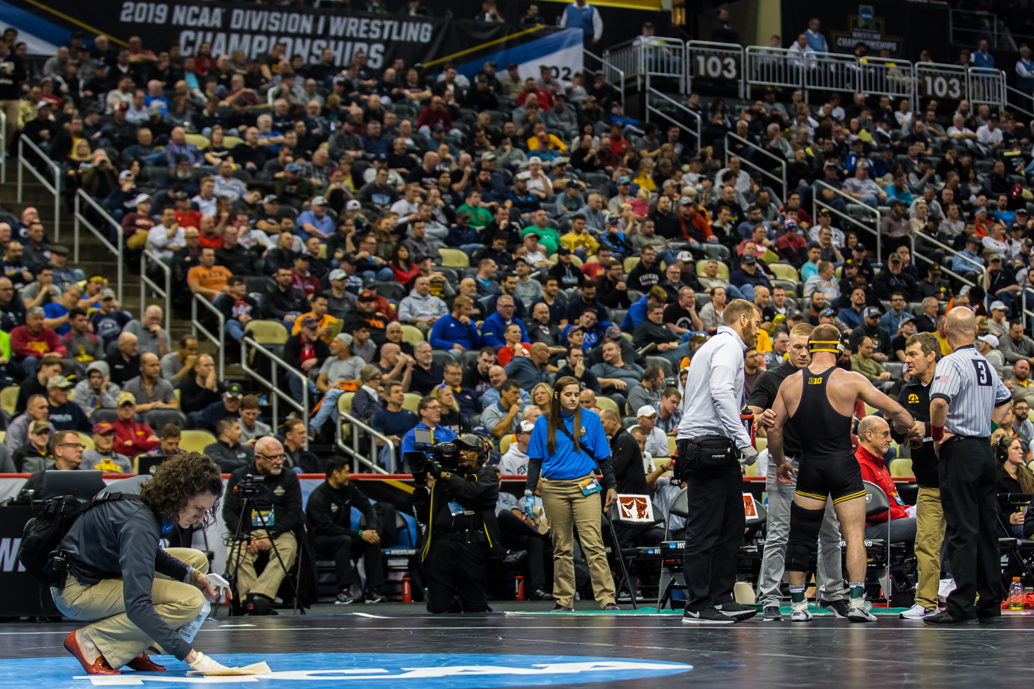 Iowa%E2%80%99s+165-pound+Alex+Marinelli+talks+to+coaches+during+a+blood+timeout+during+the+fifth+session+of+the+2019+NCAA+D1+Wrestling+Championships+at+the+PPG+Paints+Arena+in+Pittsburgh%2C+PA+on+Saturday%2C+March+23%2C+2019.+Marinelli+won+by+decision%2C+9-3%2C+and+earned+seventh+in+the+weight+class.