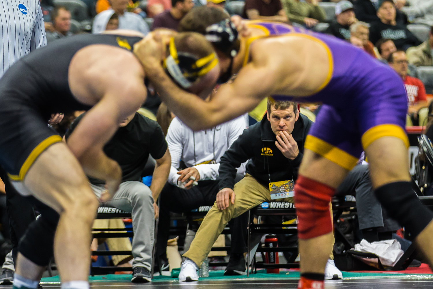 Iowa's 165-pound Alex Marinelli wrestles Northern Iowa's Bryce Steiert during the fifth session of the 2019 NCAA D1 Wrestling Championships at the PPG Paints Arena in Pittsburgh, PA on Saturday, March 23, 2019. Marinelli won by decision, 9-3, and earned seventh in the weight class.