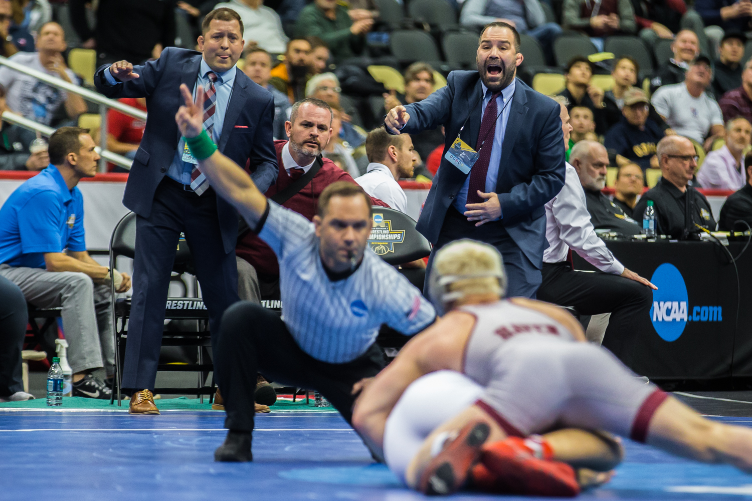 Lock+Haven+coaches+yell+on+the+mat+while+165-pound+Chance+Marsteller+scores+a+takedown+on+Wisconsin%27s+Evan+Wick+during+the+fifth+session+of+the+2019+NCAA+D1+Wrestling+Championships+at+the+PPG+Paints+Arena+in+Pittsburgh%2C+PA+on+Saturday%2C+March+23%2C+2019.+Marsteller+won+by+decision%2C+6-5%2C+and+clinched+third+in+the+weight+class.