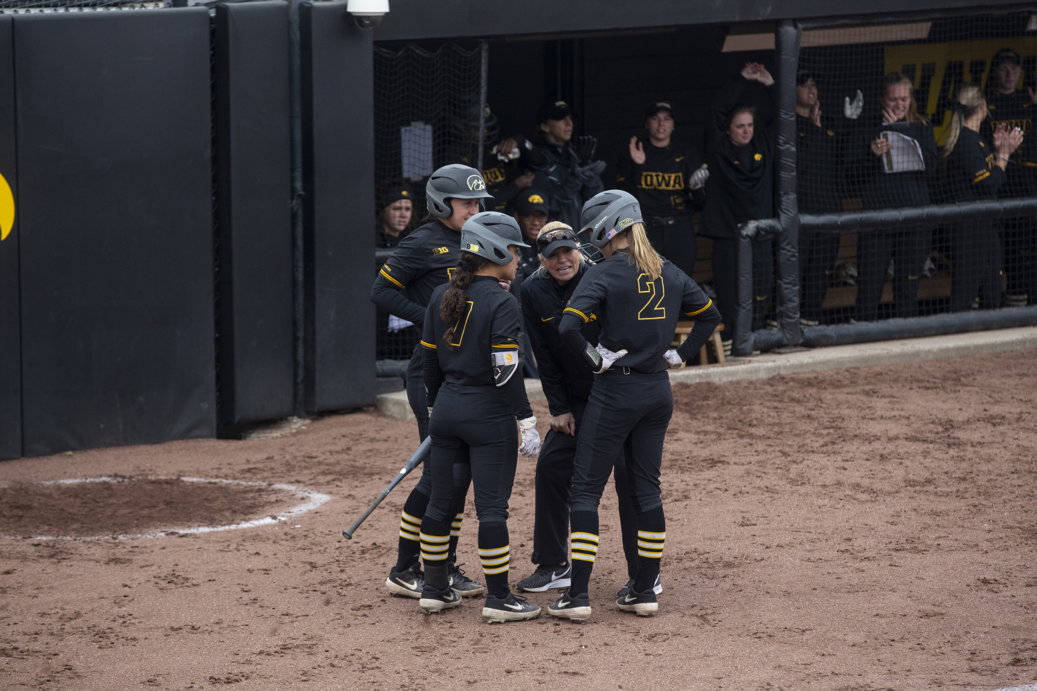 Head Coach Renee Gillispie talks with Aralee Bogar (2), Lea Thompson (7) and Mallory Kilian during softball against Northwestern on Bob Pearl Field on March 30, 2019. The Wildcats defeated the Hawkeyes 6-2.