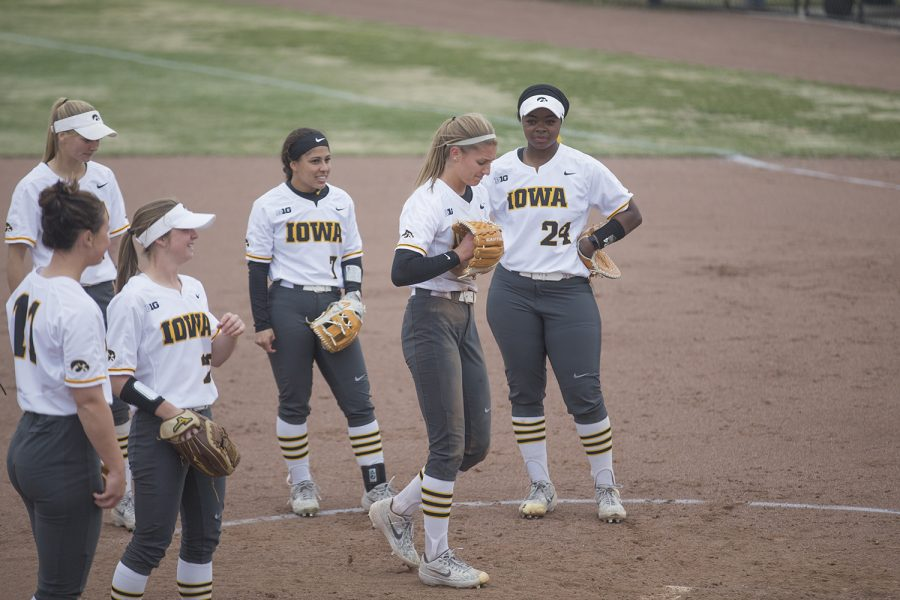 Iowa starting pitcher Allison Doocy (JR) prepares to pitch after an injury caused by a collision during the fourth inning of the conference opening softball game at Pearl Field on Friday, March 29, 2019. The Wildcats defeated the Hawkeyes 5-1.