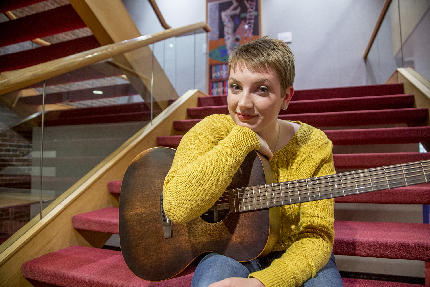 UI junior Clara Reynen poses for a portrait at the Theatre Building on Wednesday, March 6, 2019. Reynen writes her own folk music and performs on stage when not doing stand-up comedy.