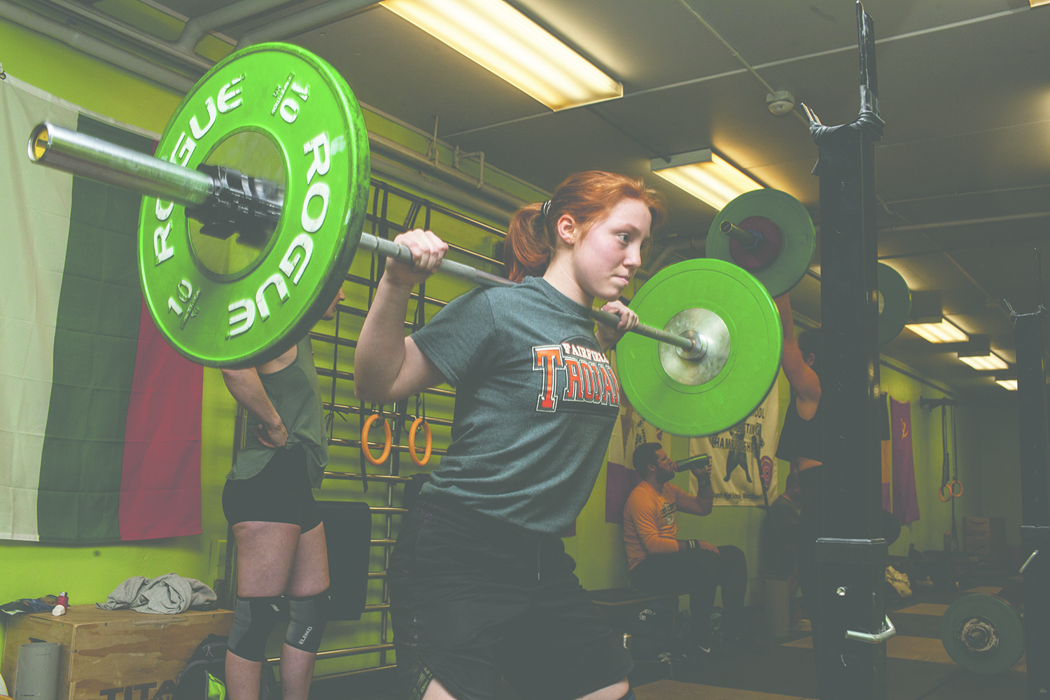 A club member squats during a practice session for Got Strength powerlifting club at the Robert A. Lee Recreation Center in Iowa City on Thursday, February 28, 2019. Got Strength was started by Coach Phil Johnson in 2005 and was held in his privately owned gym. The club moved in 2017 when it began working with the Iowa City Parks and Recreation Department. (Wyatt Dlouhy/The Daily Iowan)