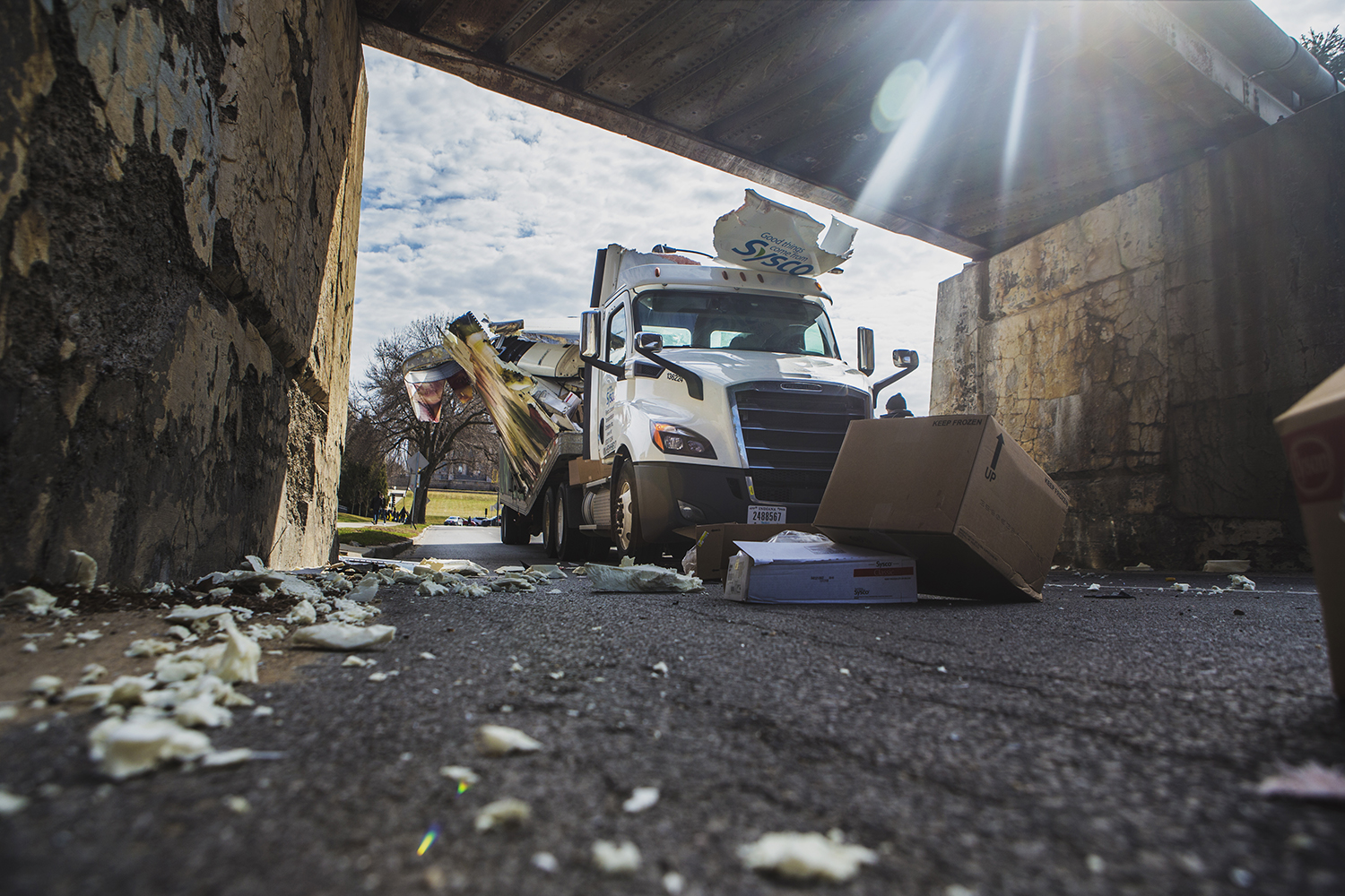 A Sysco truck crashes into the railroad above Iowa Avenue on Friday, March 29, 2019.