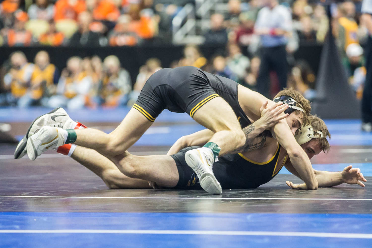 Iowa's 133-pound Austin DeSanto wrestles Appalachian State's Cody Russell during the first session of the 2019 NCAA D1 Wrestling Championships at PPG Arena in Pittsburgh, PA on Thursday, March 21, 2019. Russell was disqualified, advancing DeSanto.