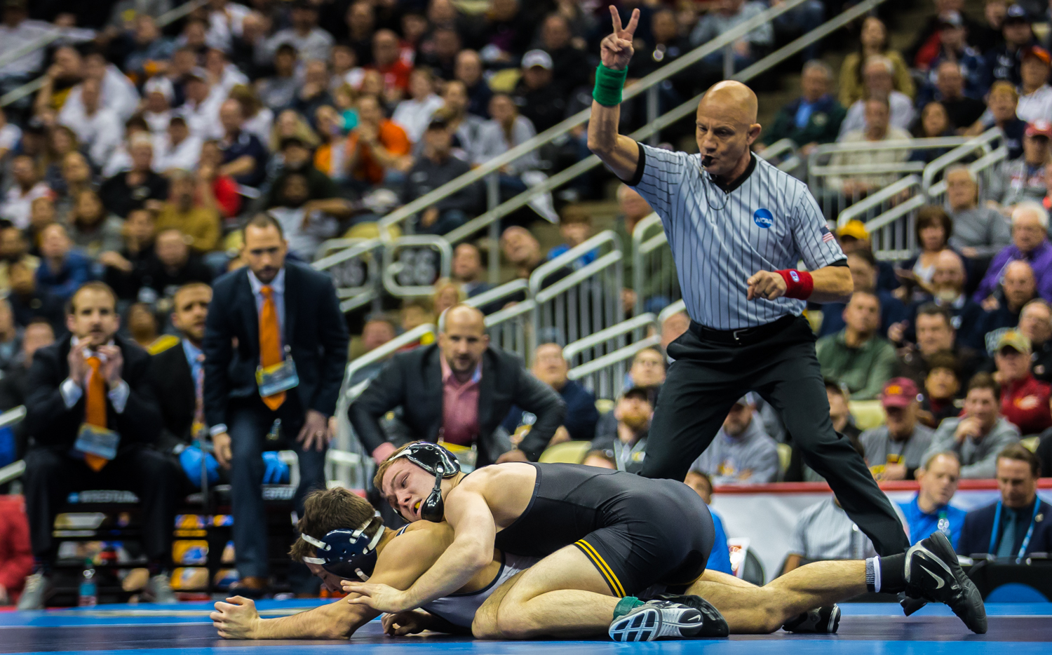 Iowa's 125-pound Spencer Lee wrestles Virginia's Jack Mueller during the final session of the 2019 NCAA D1 Wrestling Championships at PPG Paints Arena in Pittsburgh, PA on Saturday, March 23, 2019. Lee won by decision, 5-0, and defended his national title.