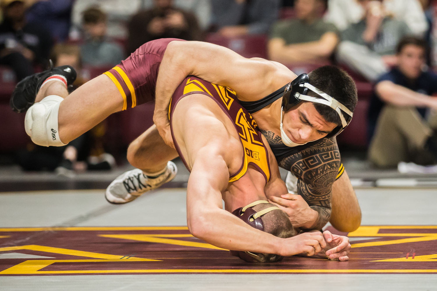Iowa's 149-lb Pat Lugo wrestles Minnesota's Thomas Thorn during the third session of the 2019 Big Ten Wrestling Championships in Minneapolis, MN on Sunday, March 10, 2019. Lugo won by decision, 6-4.