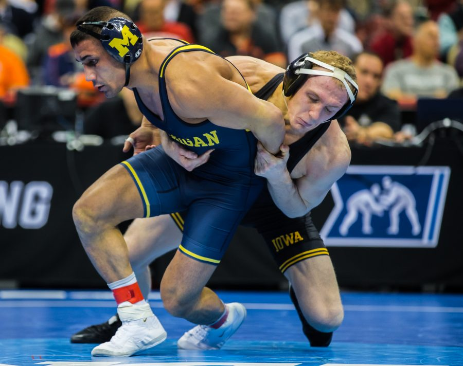 Iowa%E2%80%99s+157-pound+Kaleb+Young+wrestles+Michigan%E2%80%99s+Alec+Pantaleo+during+the+fifth+session+of+the+2019+NCAA+D1+Wrestling+Championships+at+the+PPG+Paints+Arena+in+Pittsburgh%2C+PA+on+Saturday%2C+March+23%2C+2019.+Pantaleo+won+by+decision%2C+6-2.