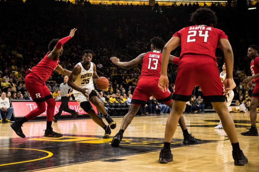 Iowa forward Tyler Cook navigates the defense during a men's basketball match between Iowa and Rutgers at Carver-Hawkeye Arena on Saturday, March 2, 2019. The Hawkeyes, celebrating senior night, fell to the Scarlet Knights, 86-72.