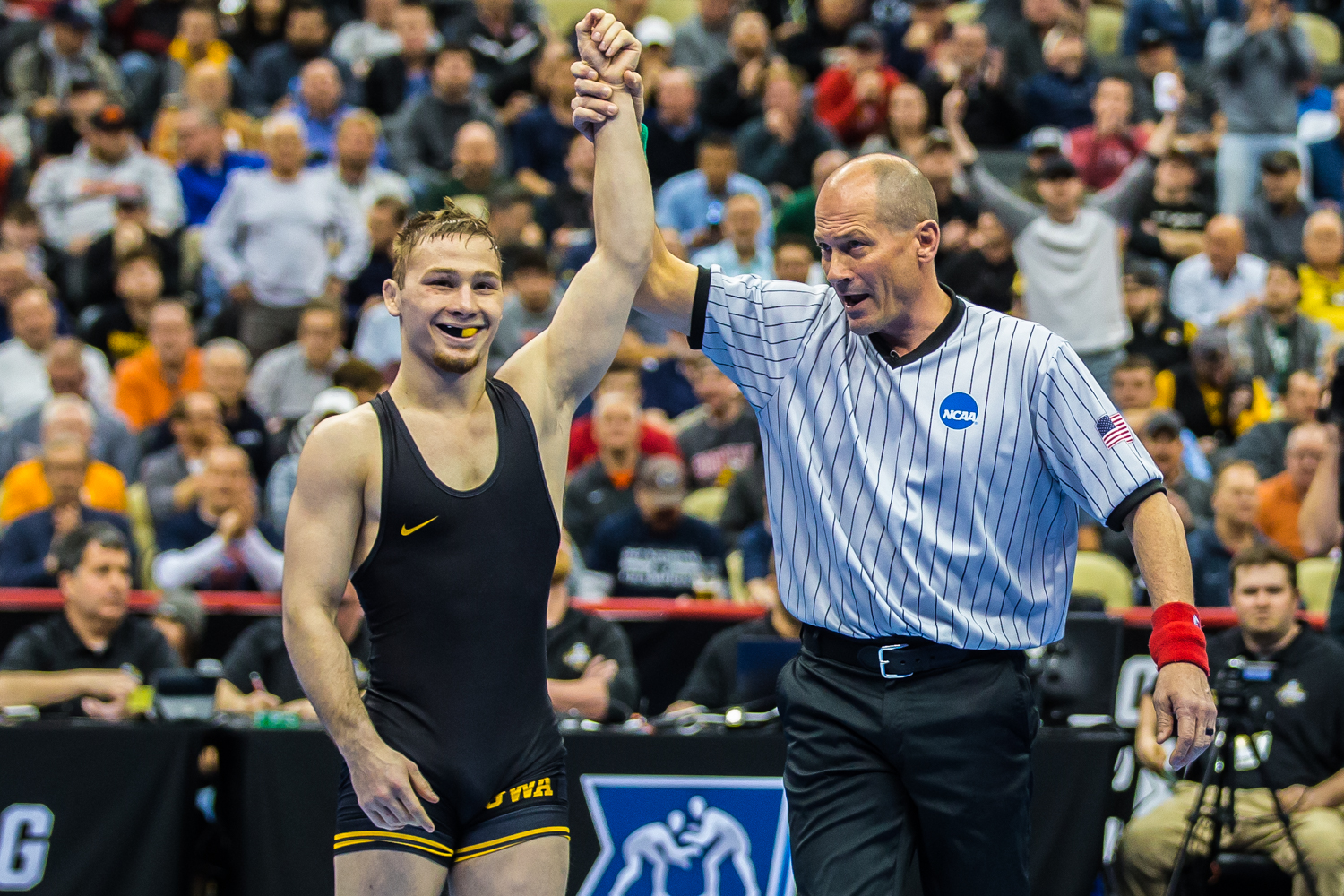 Iowa's 125-pound Spencer Lee defeats Oklahoma State's Nicholas Piccininni during the fourth session of the 2019 NCAA D1 Wrestling Championships at PPG Paints Arena in Pittsburgh, PA on Friday, March 22, 2019. Lee won by decision, 11-4, and earned a spot in the finals of his weight class.