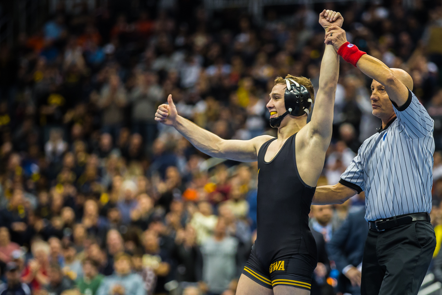 Iowa's 125-pound Spencer Lee celebrates defeating Virginia's Jack Mueller during the final session of the 2019 NCAA D1 Wrestling Championships at PPG Paints Arena in Pittsburgh, PA on Saturday, March 23, 2019. Lee won by decision, 5-0, and defended his national title.