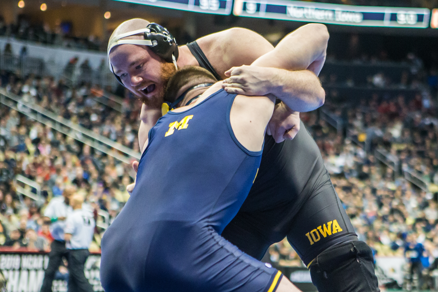 Iowa's 285-pound Sam Stoll wrestles Michigan's Mason Parris during the first session of the 2019 NCAA D1 Wrestling Championships at PPG Arena in Pittsburgh, PA on Thursday, March 21, 2019. Stoll won by decision, 8-5.