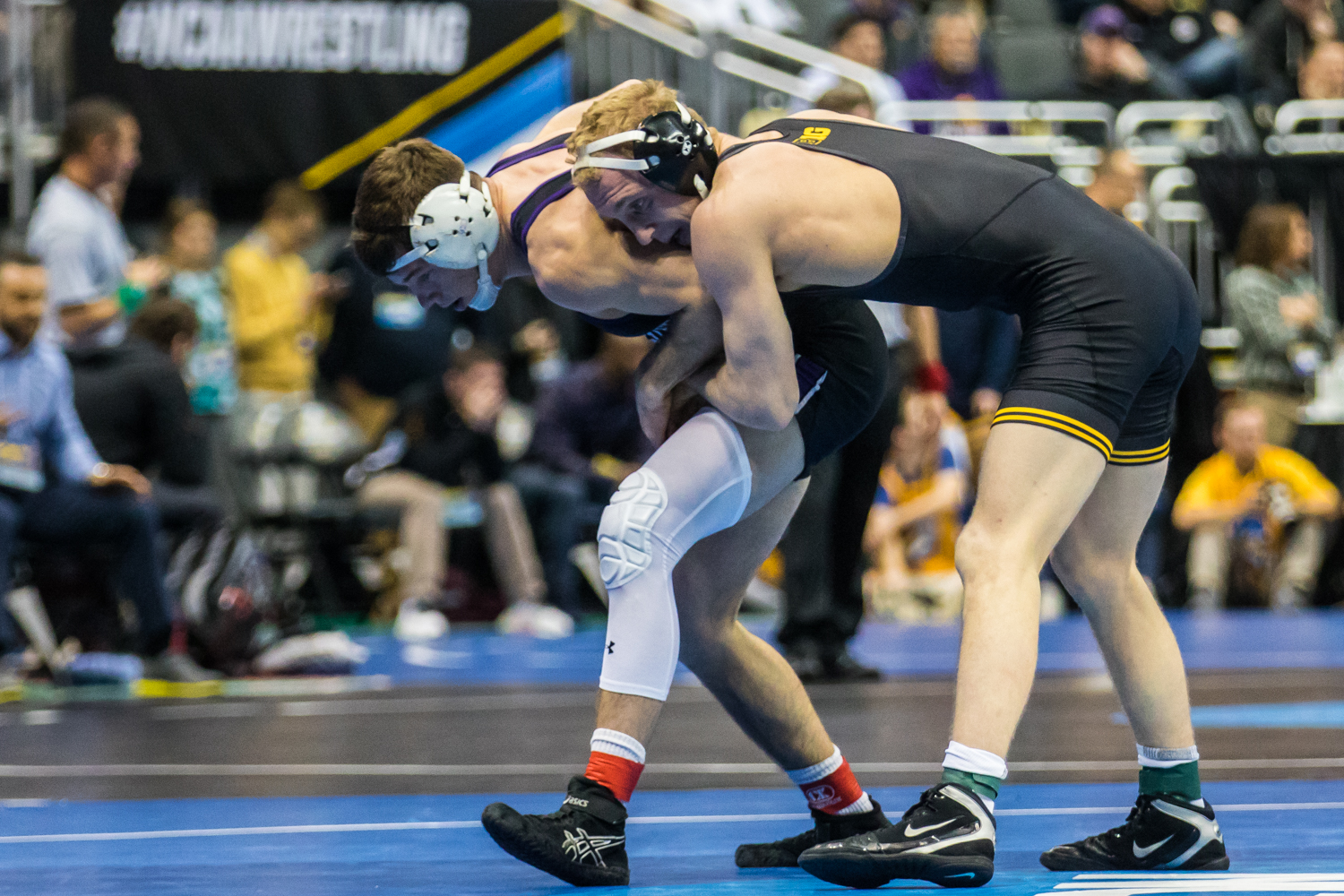 Iowa's 157-pound Kaleb Young wrestles Northwestern's Ryan Deakin during the third session of the 2019 NCAA D1 Wrestling Championships at PPG Paints Arena in Pittsburgh, PA on Friday, March 22, 2019. Young won by sudden victory, 7-5.