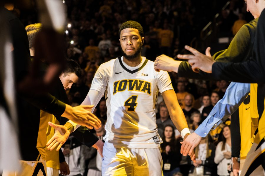 Iowa+guard+Isaiah+Moss+is+introduced+before+a+men%27s+basketball+match+between+Iowa+and+Rutgers+at+Carver-Hawkeye+Arena+on+Saturday%2C+March+2%2C+2019.+The+Hawkeyes%2C+celebrating+senior+night%2C+fell+to+the+Scarlet+Knights%2C+86-72.+