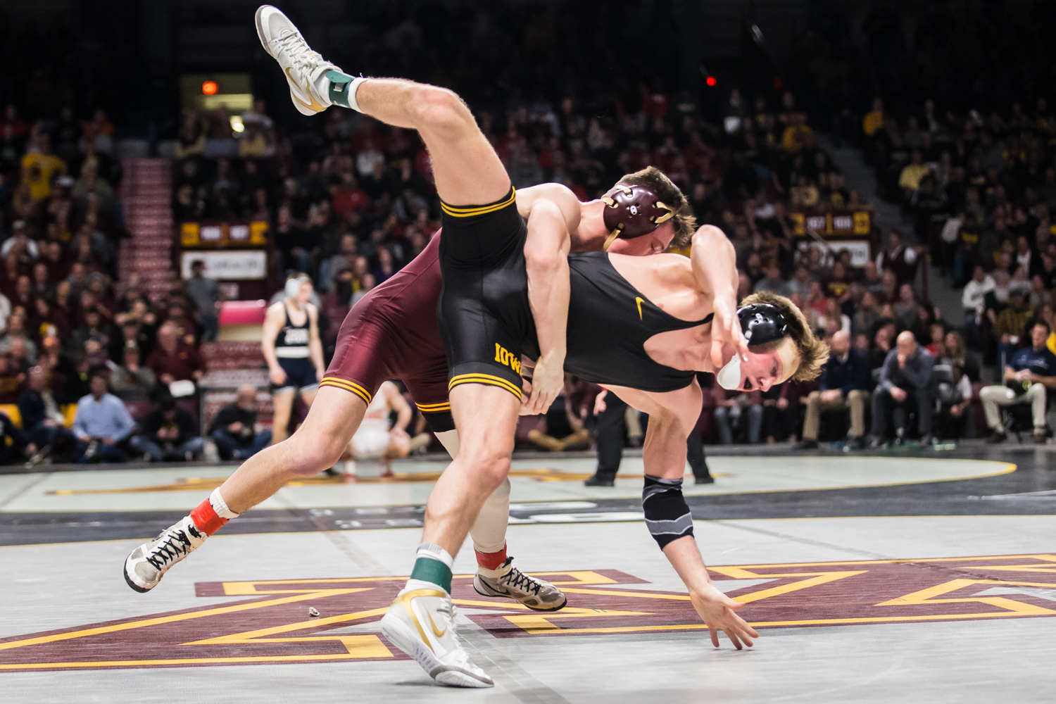 Iowa's 141-lb Max Murin wrestles Minnesota's Mitch McKee during the second session of the 2019 Big Ten Wrestling Championships in Minneapolis, MN on Saturday, March 9, 2019. McKee won by decision, 2-1.
