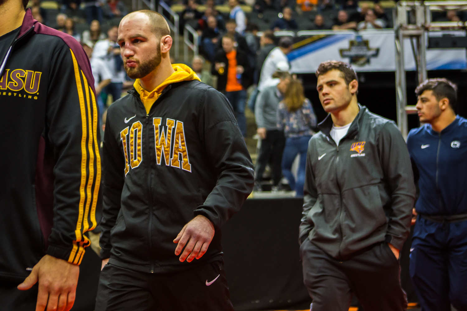 Iowa%27s+Alex+Marinelli+walks+across+the+show+floor+during+the+Parade+of+All+Americans+at+the+2019+NCAA+D1+Wrestling+Championships+at+PPG+Paints+Arena+in+Pittsburgh%2C+PA+on+Saturday%2C+March+23%2C+2019.+Six+of+Iowa%E2%80%99s+wrestlers+earned+the+distinction.