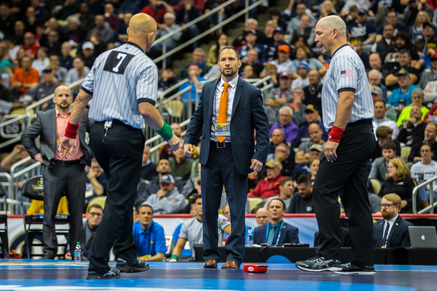 Virginia+head+coach+Steve+Garland+throws+the+challenge+brick+during+the+125-pound+final+bout+at+the+2019+NCAA+D1+Wrestling+Championships+at+PPG+Paints+Arena+in+Pittsburgh%2C+PA+on+Saturday%2C+March+23%2C+2019.+Lee+won+by+decision%2C+5-0%2C+and+defended+his+national+title.
