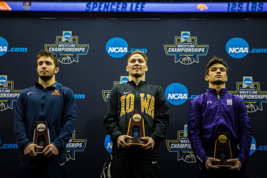Iowa's Spencer Lee holds the first-place trophy for the 125-pound weight class during the final session of the 2019 NCAA D1 Wrestling Championships at PPG Paints Arena in Pittsburgh, PA on Saturday, March 23, 2019.